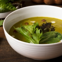 Baby Greens Soup with Coconut Milk, Sweet Curry, and Tamarind